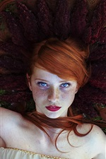 Preview iPhone wallpaper Red hair girl, freckles, lying on flowers