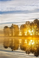 Preview iPhone wallpaper River, sunrise, trees, clouds, sun rays, morning, fog
