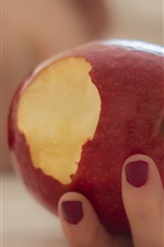 Preview iPhone wallpaper A red apple in hand