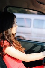 Asian girl driving car