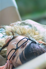 Preview iPhone wallpaper Asian girl lying on railway side, glasses