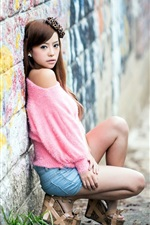 Preview iPhone wallpaper Asian girl, pink clothes, back to the wall