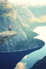 Beautiful nature landscape, lake, mountains, rocks, sun rays, girl, yoga