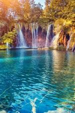 Beautiful waterfall, lake, trees, sun rays