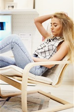 Blonde girl sit on chair to rest