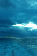 Preview iPhone wallpaper Blue sea, clouds, sun rays, dusk
