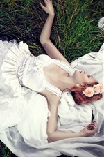 Preview iPhone wallpaper Bride lying on grass, white dress