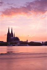 Preview iPhone wallpaper Cologne, Germany, morning, buildings, bridge, river, red sky