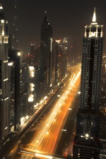 Preview iPhone wallpaper Dubai, city night, skyscrapers, lights, road
