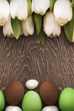 Preview iPhone wallpaper Easter theme, white tulips, colorful eggs, wood board