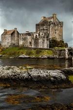 Eilean Donan castle, Scotland, river, stones, clouds