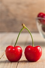Preview iPhone wallpaper Fresh red cherries, wood board, bowl