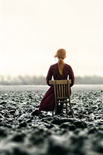 Preview iPhone wallpaper Girl sit on chair, rear view, arable land