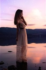 Preview iPhone wallpaper Girl standing at lakeside, water, sunset, stars
