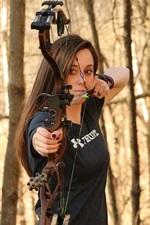 Preview iPhone wallpaper Girl use compound bow, archery, forest