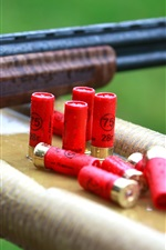 Preview iPhone wallpaper Gun, ammunition, rain, weapon