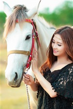 Happy Asian girl and white horse