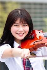 Happy Asian girl play violin