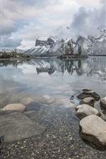 Preview iPhone wallpaper Lake Minnewanka, mountains, stones, fog, Alberta, Canada, Banff National Park