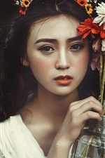 Preview iPhone wallpaper Lovely Asian girl and flowers