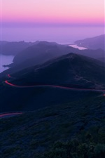 Preview iPhone wallpaper Mountains, road, light, sea, dusk