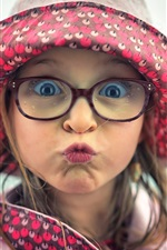 Playful child girl, face, hat, glasses