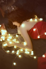 Red dress Asian girl lie on floor, lights