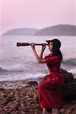 Preview iPhone wallpaper Red dress girl use binoculars, sea, stones