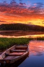 Sunset, red sky, clouds, lake, boat, grass