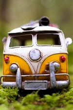 Preview iPhone wallpaper Toy car in the grass