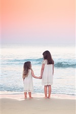 Preview iPhone wallpaper Two child girls on beach, sea, waves