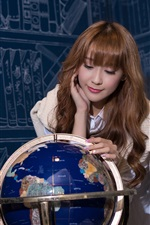 Preview iPhone wallpaper Asian girl and globe