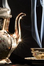 Beautiful kettle, cup, steam