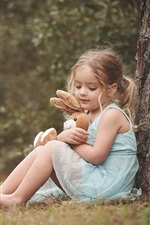 Preview iPhone wallpaper Blonde child girl, toy, sit under tree