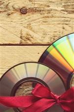 CD, red ribbon, wood board