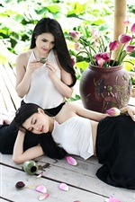 Preview iPhone wallpaper Chinese girls, pink lotus, pond, leaves