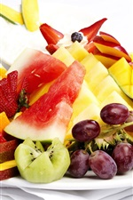 Fresh fruit dessert, grapes, strawberries, mango, watermelon, oranges