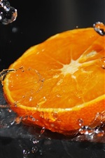 Preview iPhone wallpaper Half piece orange, water splash