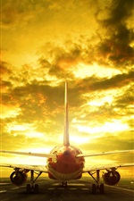 Preview iPhone wallpaper Passenger plane, runway, rear view, evening, glow, clouds