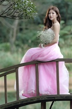 Preview iPhone wallpaper Pink dress Asian girl stand on bridge