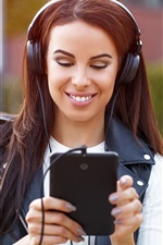 Preview iPhone wallpaper Smile girl use tablet, headphones
