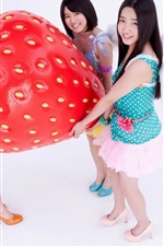 Preview iPhone wallpaper Three Asian girls and big strawberry