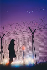 Preview iPhone wallpaper Barbed wire, silhouette, man, night, lights