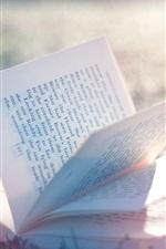 Preview iPhone wallpaper Book, grass, sunshine, glare