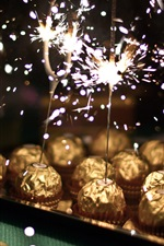 Preview iPhone wallpaper Chocolate ball candy, sparks