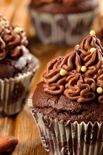 Preview iPhone wallpaper Chocolate cupcakes, cake, cream