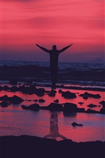 Preview iPhone wallpaper Guy jump, sunset, evening, water, shore