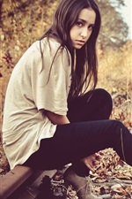 Preview iPhone wallpaper Long hair girl sit on railroad, autumn