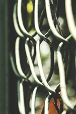 Preview iPhone wallpaper Metal fence, blurry