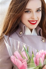Smile girl and pink tulips